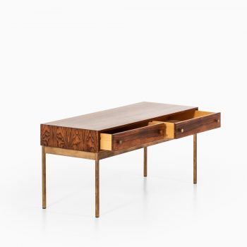 Poul Nørreklit side table in rosewood and brass at Studio Schalling