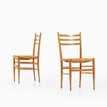 Set of 8 dining chairs in beech and seagrass at Studio Schalling