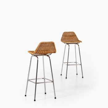 Bar stools in steel and rattan at Studio Schalling