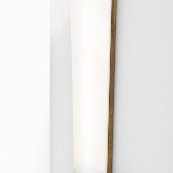 Large wall lamp in brass and white plastic at Studio Schalling