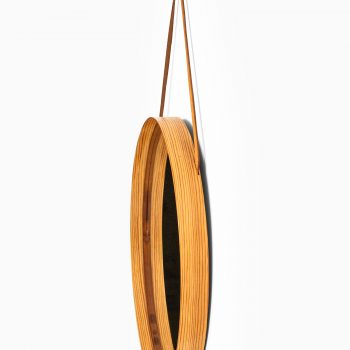 Round mirror in pine, brass and leather at Studio Schalling