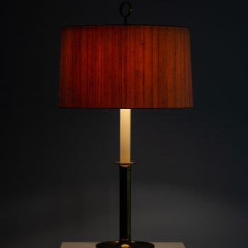 Pair of tall table lamps in brass at Studio Schalling
