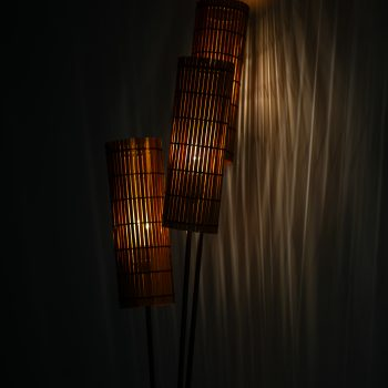 Floor lamp in brass and wooden shades at Studio Schalling