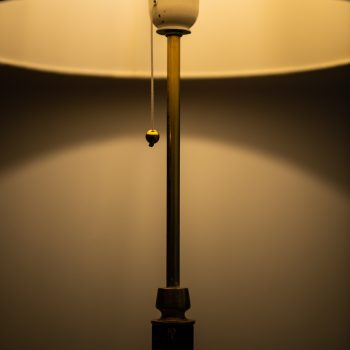 Floor lamps in brass and leather by Falkenbergs Belysning AB at Studio Schalling