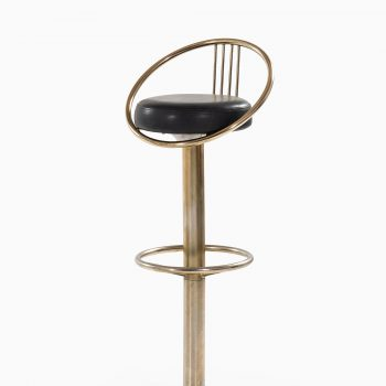 Bar stools in brass and black leather at Studio Schalling