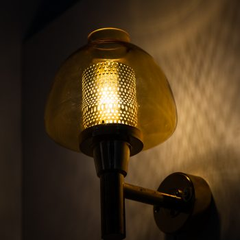 Hans-Agne Jakobsson wall lamps in brass and glass at Studio Schalling