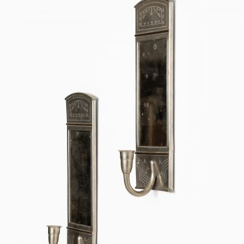 Wall candlesticks in pewter and brass at Studio Schalling