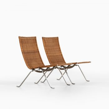 Poul Kjærholm PK-22 easy chairs in steel and rattan at Studio Schalling