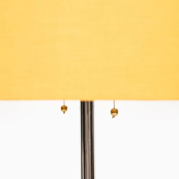 Large floor lamp with tripod base at Studio Schalling
