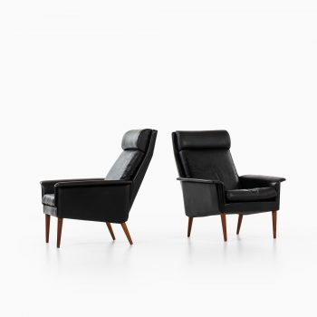 Pair of easy chairs in teak and black leather at Studio Schalling