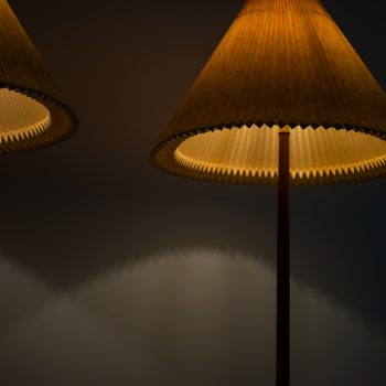 A pair of floor lamps in mahogany at Studio Schalling