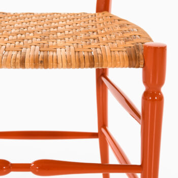 Side chair in red lacquered wood and cane at Studio Schalling