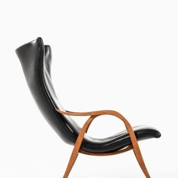 Frits Henningsen easy chair in oak and black leather at Studio Schalling