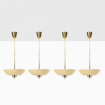 Paavo Tynell ceiling lamps in brass and glass at Studio Schalling