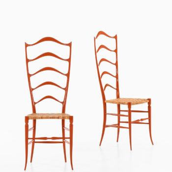 Side chairs in red lacquered wood and cane at Studio Schalling