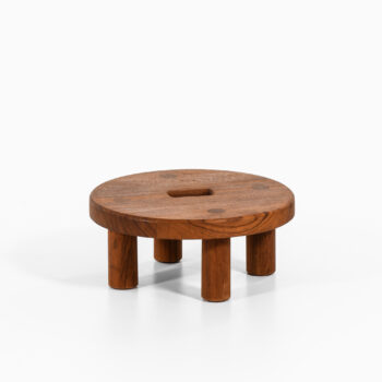 Low stool in teak at Studio Schalling