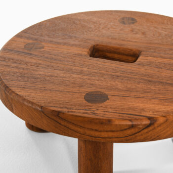 Low stool in teak at Studio Schalling