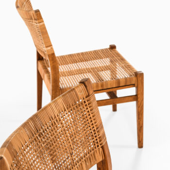 Dining chairs in oak and cane by unknown designer at Studio Schalling
