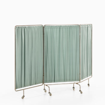 Room divider on wheels in steel and fabric at Studio Schalling