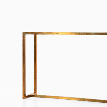 Console table in brass and glass at Studio Schalling