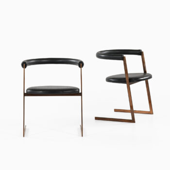 Dining chairs in bronze and black leather at Studio Schalling