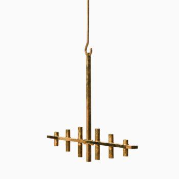 Large hanging chandelier in brass at Studio Schalling
