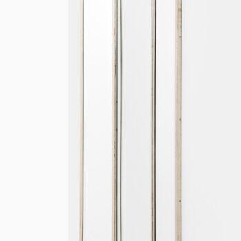 Large mirror in nickel plated brass at Studio Schalling