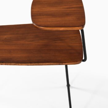 Side tables in teak and black lacquered metal at Studio Schalling