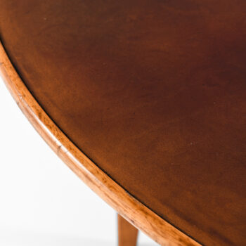 Elias Svedberg dining table with leather top at Studio Schalling