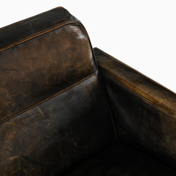 Sofa in black painated leather at Studio Schalling