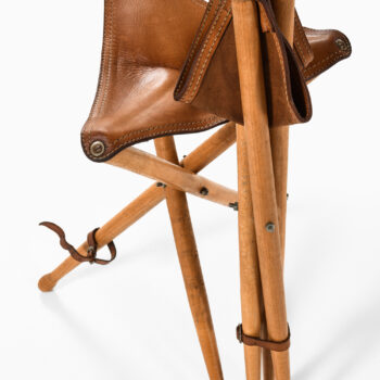 A pair of hunting stools in leather and beech at Studio Schalling