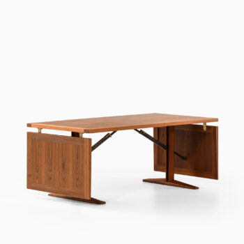Dining table in teak and brass at Studio Schalling