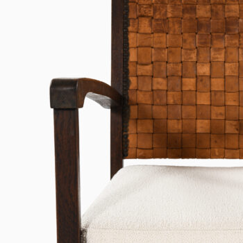 Easy chairs in dark stained oak and leather at Studio Schalling