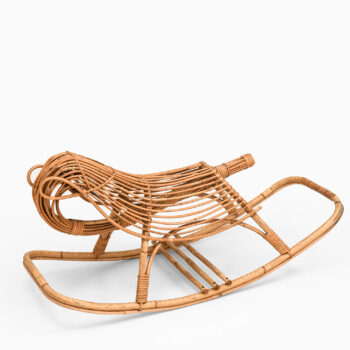 Rocking chair in rattan and cane for children at Studio Schalling