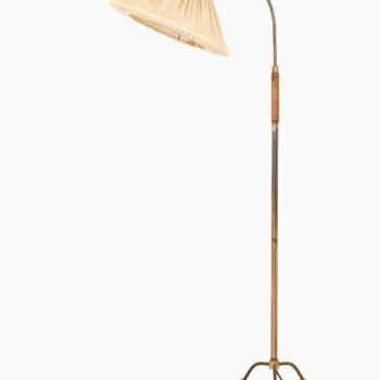 Tripod floor lamp in brass and mahogany at Studio Schalling