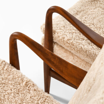 Easy chairs in beech and sheepskin at Studio Schalling