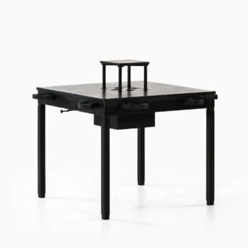 Game table in black lacquered wood at Studio Schalling