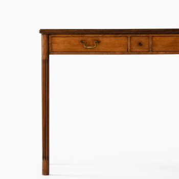 Console table in mahogany and brass at Studio Schalling