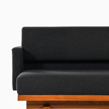 Sofa in mahogany and wool upholstery at Studio Schalling