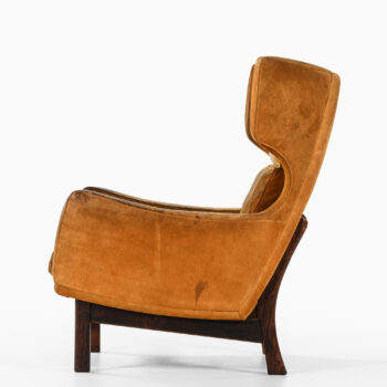Rare wingback easy chair in suede at Studio Schalling