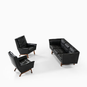 Sofa in rosewood and black leather at Studio Schalling
