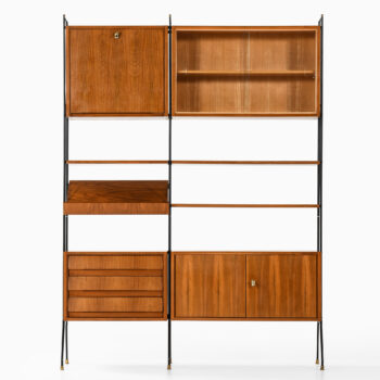 Bookcase in walnut, brass and lacquered metal at Studio Schalling