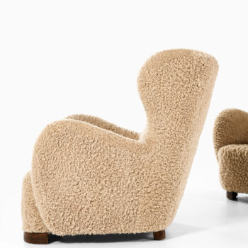 Pair of easy chairs in lambskin at Studio Schalling